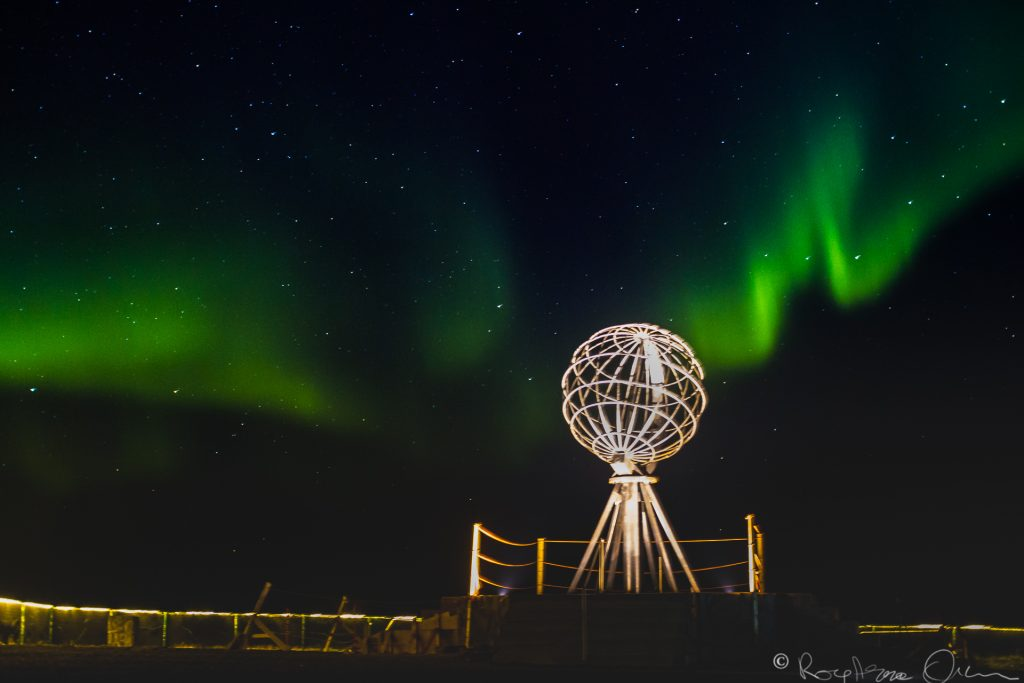 Aurora Borealis  over the globe at North Cape.