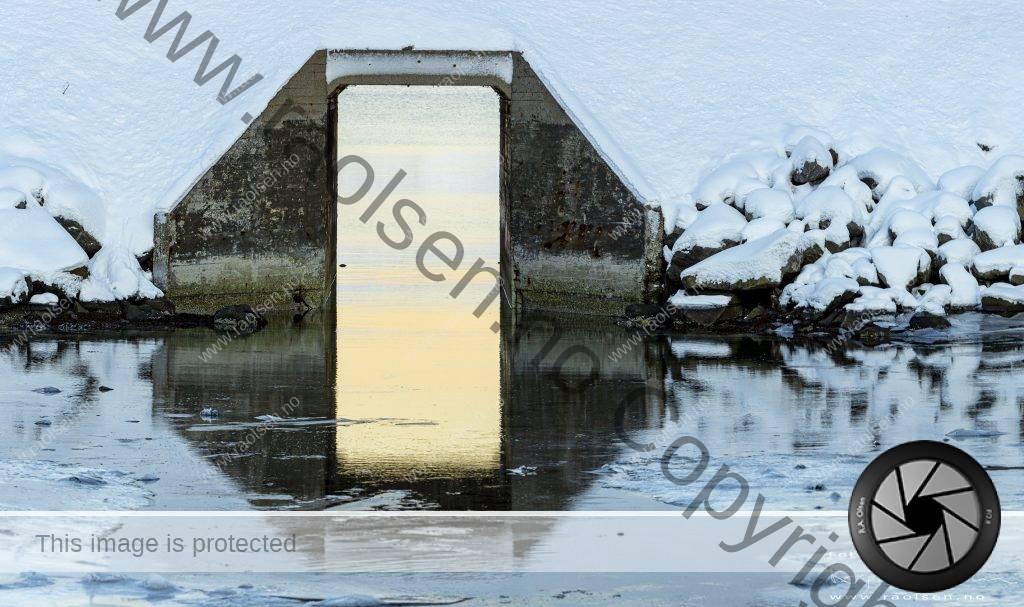 Reflections underneath a small bridge.